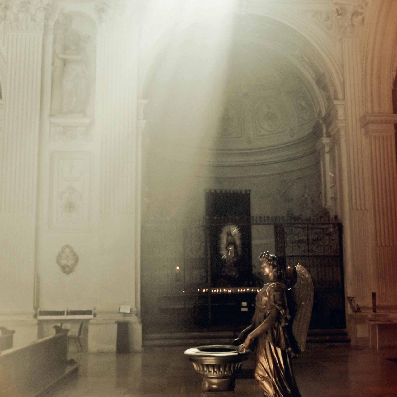 Light filters through a church window in Munich.