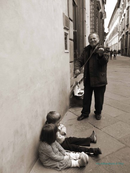 Taking time to enjoy a private concert in the quiet streets of Lucca.