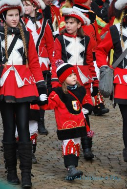 Children join in the Fashing parades, continuing family and community traditions