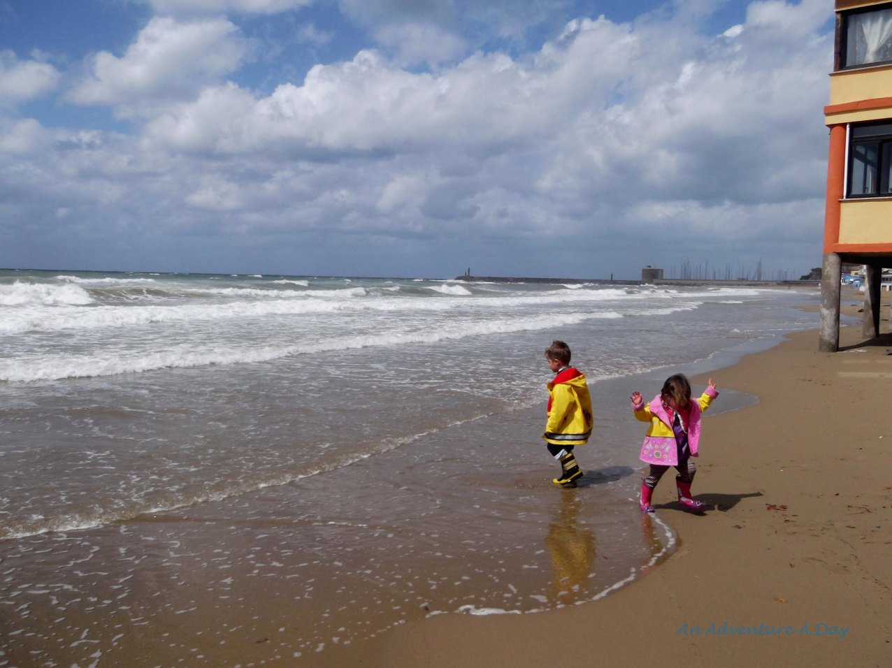 As the sun made its way through the clouds, the children enjoyed a few moments in the surf.