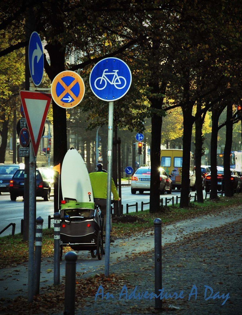 While you expect to cross paths with bikes in Munich, you may not expect to see them with a surfboard in tow.