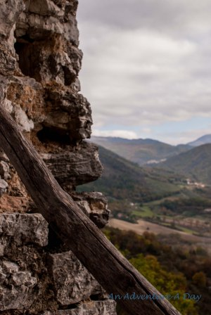 The crumbled remains of a castle window still look down on the valley below.