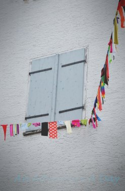 A colorful bunting is strung throughout the streets before the festivities.