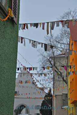 The buildings seem even more cheerful than usual with the colorful bunting.