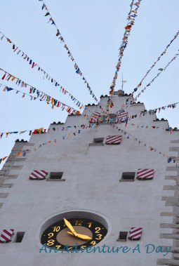 Even the town's tower is decorated for the festivities.