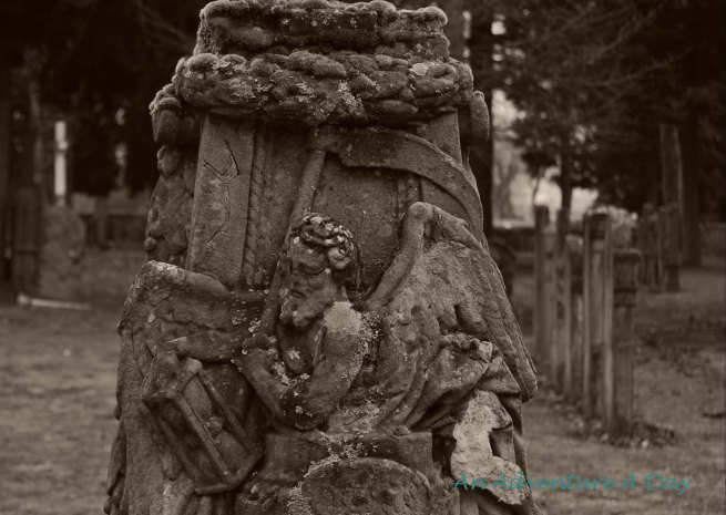 A solemn figure on a grave marker in Pfullendorf's cemetery.