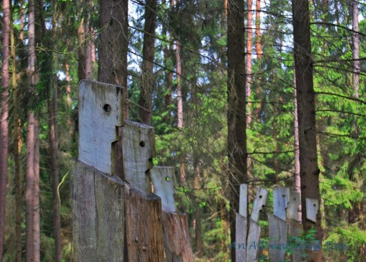 A row of faces stands watch along the trail of the kunstwald in Burglengenfeld.