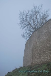castle walls in the fog