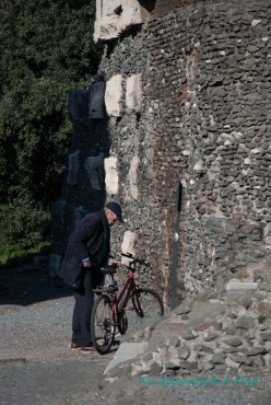Near the Tomb of Cecelia, a biker gets ready to take off.