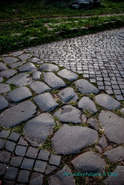 In places, the old stones are preserved among the newer stones on the Appia Antica