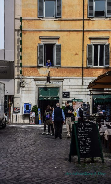 The quintessential sighting - a Nonna in the window overlooking a busy square.